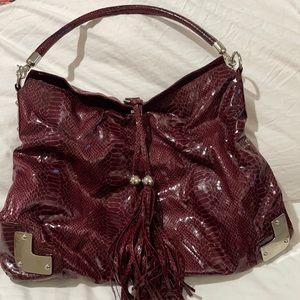 Red snakeskin like large should bag silver details tassel closure euc vintage